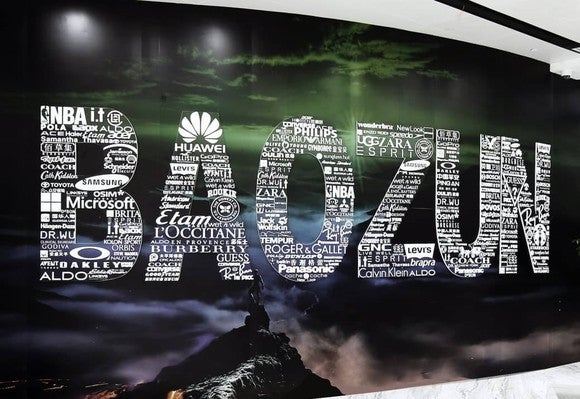 A sign that says Baozun whose letters are made up of various company names