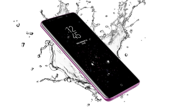 The Samsung S9 is pictured with splashing water around it and a white background for an ad