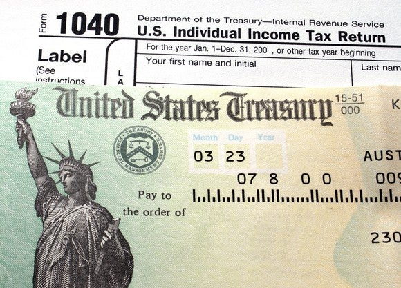 U.S. Treasury check on top of a Form 1040 tax return