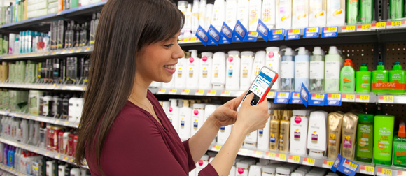 A woman using the Walmart app in store.