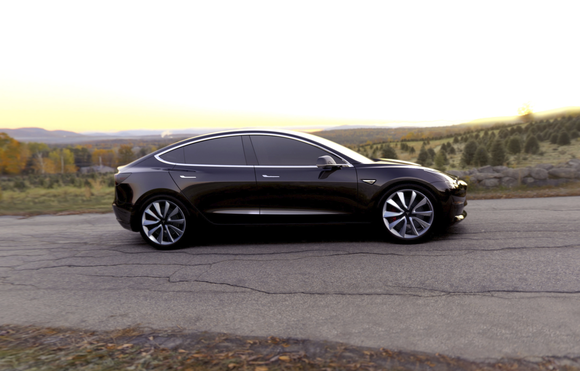Tesla's Model 3 driving on a deserted road.