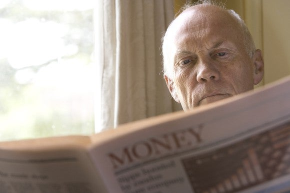 A man reading the financial section of the newspaper.
