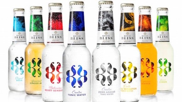 Bottles of Royal Bliss mixers on white background.