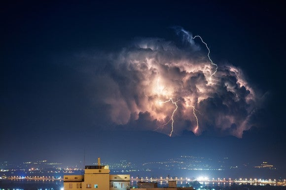 Cloud and lightning over a city at night