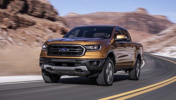 2019 Ford Ranger speeding down two-lane highway.