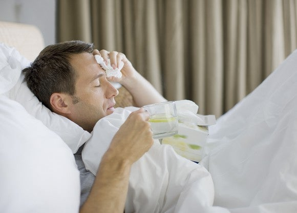 Man lying in bed as if sick