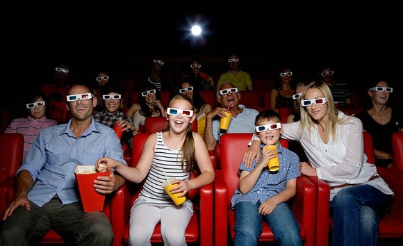 Moviegoers watching a 3D film wearing 3D glasses.