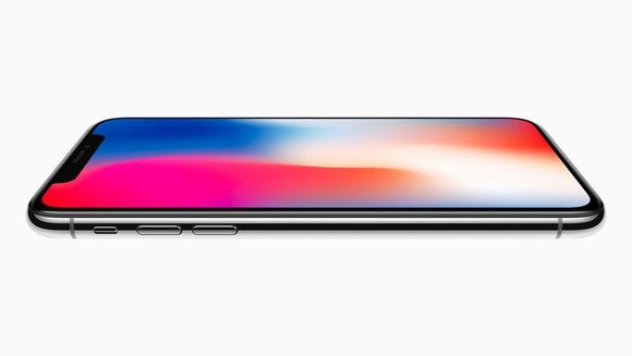 Apple's iPhone X on its back against a white background.
