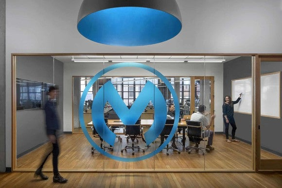 The MuleSoft logo on a glass wall in MuleSoft's offices.