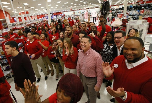 A whole lot of Target workers in red are in a store.
