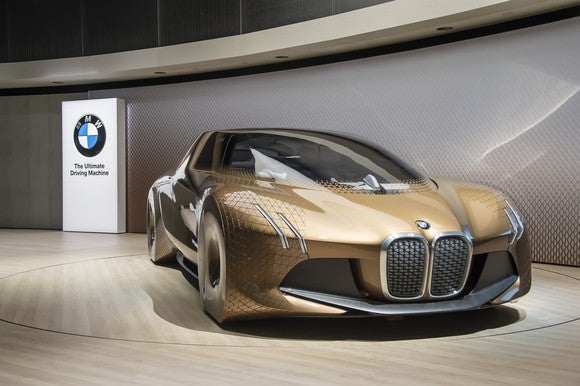 The BMW Vision Next 100 show car, a sleek futuristic-looking sedan.