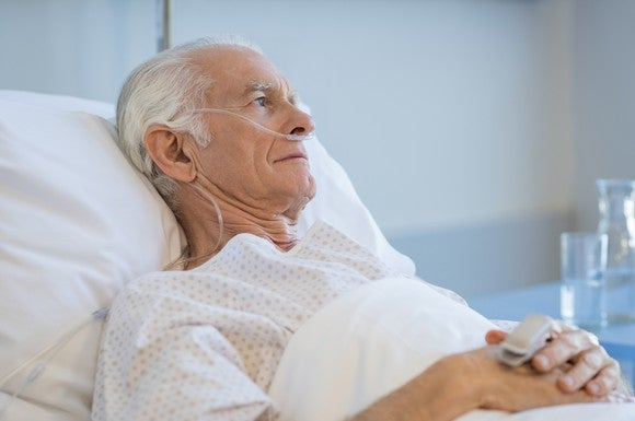 Senior man lying in bed with oxygen tube