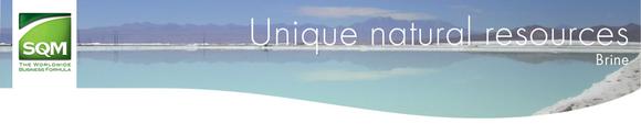 SQM logo with image of a brine evaporation pond.