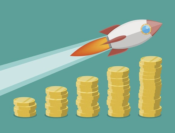 A rocket ship flying over successively taller columns of coins.