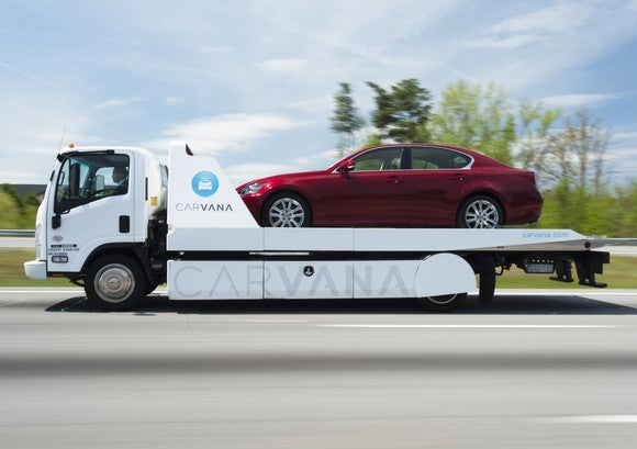 Car on the back of a Carvana trailer.
