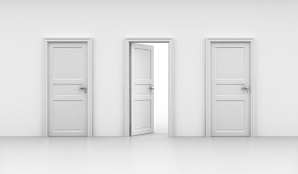 Two closed doors with one open door