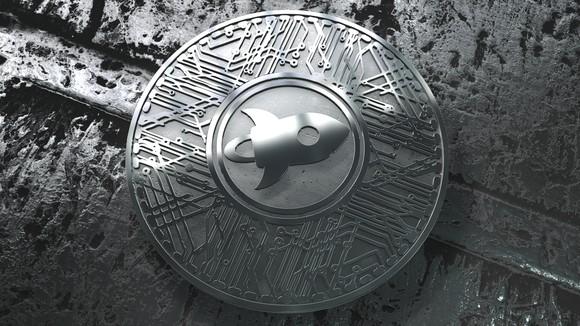 A physical silver Stellar Lumens coin.