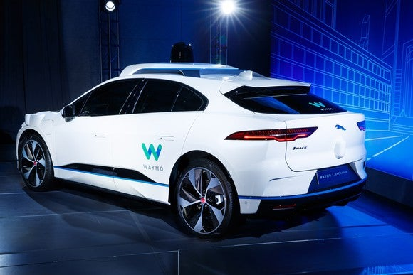 The Waymo Jaguar I-Pace, viewed from a rear three-quarter angle.