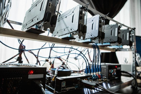 A crypto mining rig comprising video cards and fans.