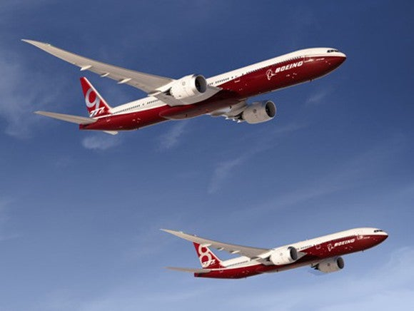Renderings of two red-and-white planes -- the Boeing 777-8 and 777-9 -- flying side by side under blue skies