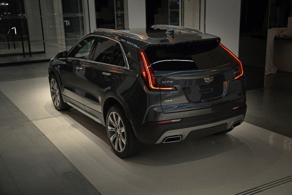 A dark gray 2019 Cadillac XT4 in Premium Luxury trim, shown at Cadillac House in New York.