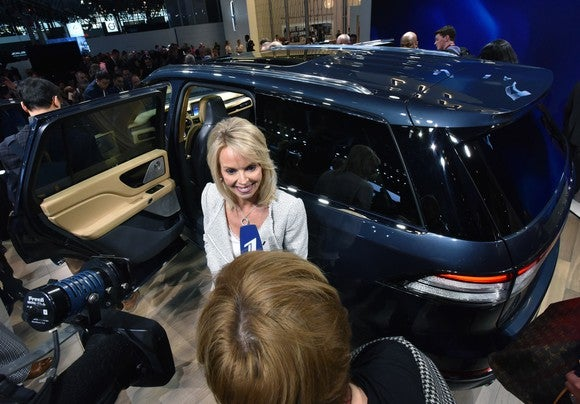 Falotico is shown standing in front of the all-new Lincoln Aviator as she is interviewed by a journalist.