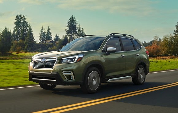 A green 2019 Subaru Forester on a country road.