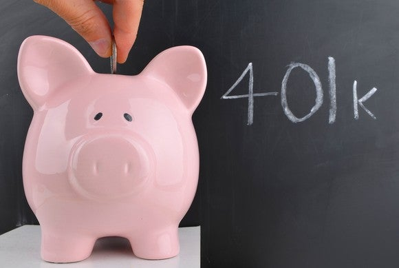 Coin being placed in a piggy bank with 401k written on a blackboard behind it