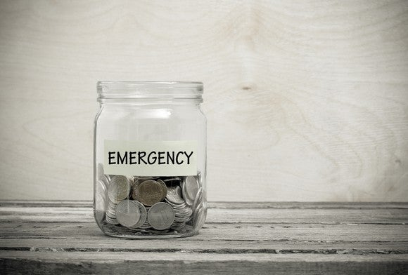 A jar labeled Emergency filled with coins