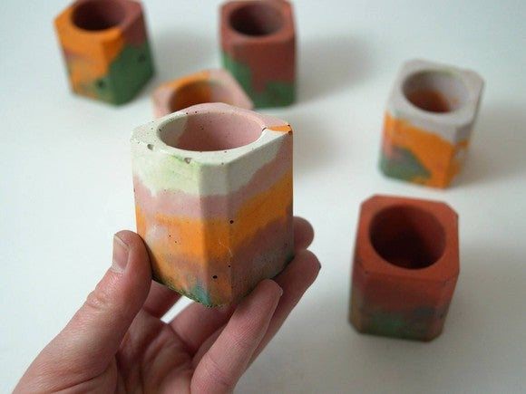 Several multicolored candle holders available on Etsy.