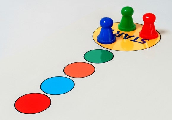 Game pieces are shown at start in a game board.