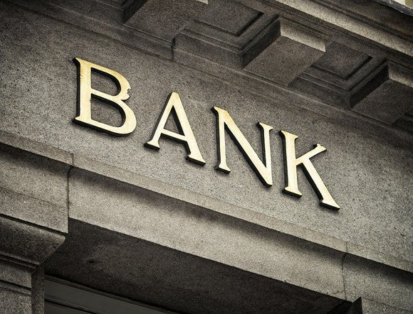 "Letters spelling out ""bank"" on a marble building."