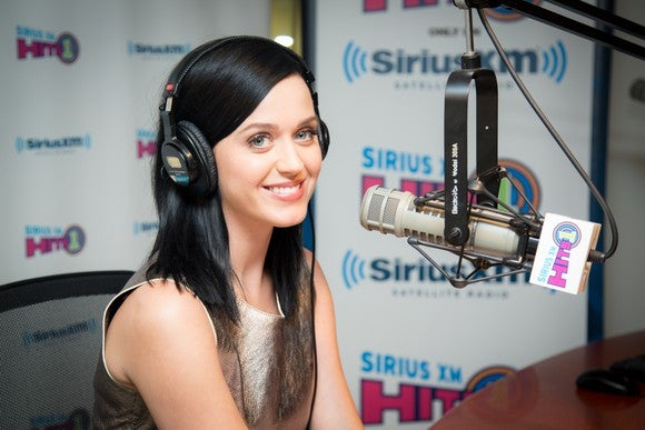 Katy Perry wearing headphones at a Sirius XM interview.