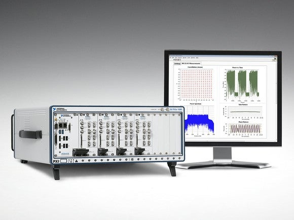 National Instruments test equipment next to a computer monitor