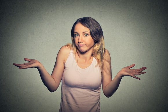 Young woman shrugging