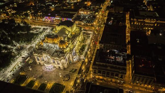 Overhead night image of the illuminated Palacio De Bella Artes, Mexico City