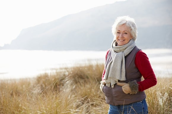 Older woman standing outdoors
