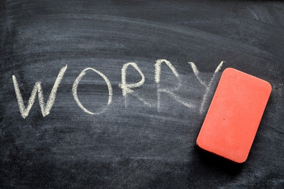 Worry written on chalkboard with eraser nearby.