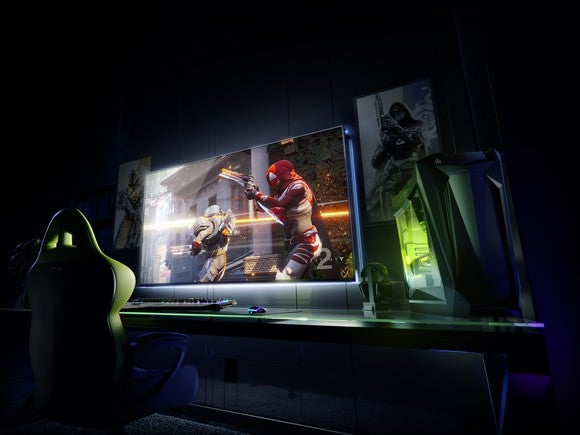 A big screen and a gaming computer on a desk.