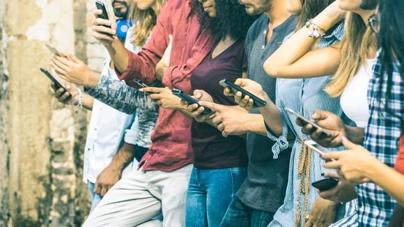 Group of people browsing their smartphones.