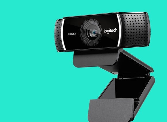 Webcam with Logitech logo against a teal background.