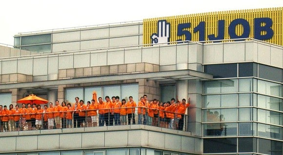 51job headquarters with employees on the outdoor patio.