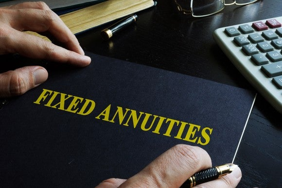 """Book on desk with """"Fixed annuities"""" printed on it."""