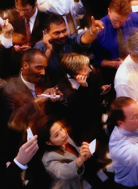 Floor traders bidding shares on a stock exchange