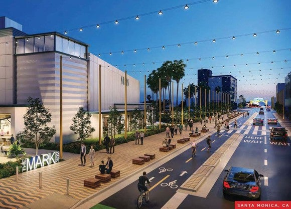 A rendering of Seritage's The Mark 302 project in Santa Monica, California showing pedestrians, cyclists, and cars moving past.