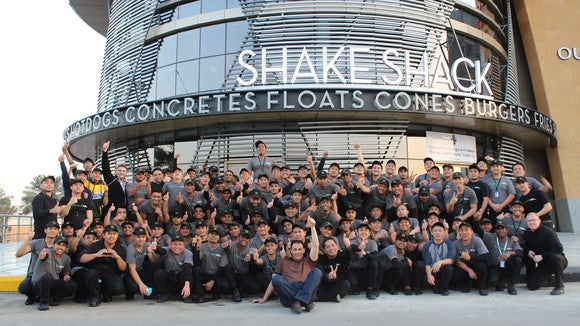 A Shake Shack grand opening with all employees in an exterior shot.