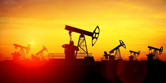 Oil pumpjacks at sunset.