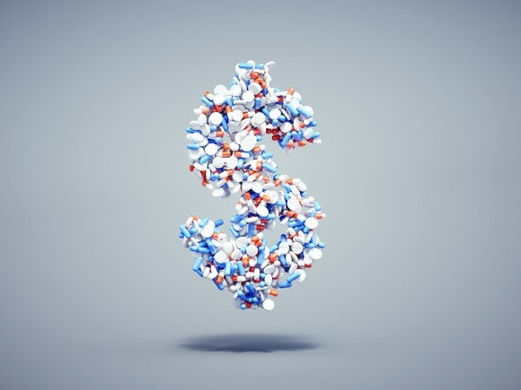 Red, white, and blue pills forming dollar sign