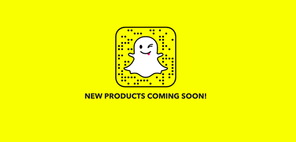 "The Snapchat ghost is seen winking against a yellow background and above the words ""new products coming soon!"""