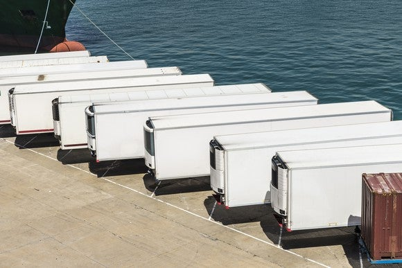 Refrigerated truck trailers in a row.